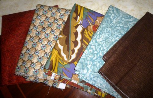 Material for Patchwork, different prints and fabrics.